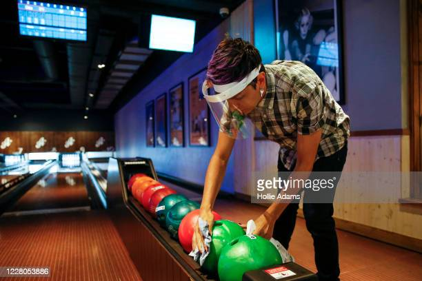 Bowling balls are cleaned between games at All Star Lanes bowling alley at Westfield in White City on August 15, 2020 in London, England. Theatres,...