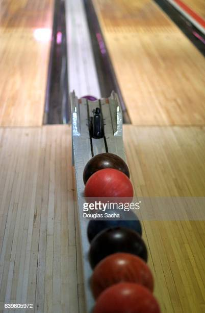 Bowling Balls lined up in the ball return area
