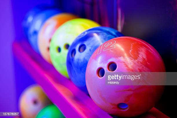 Bowling balls on ball shelves