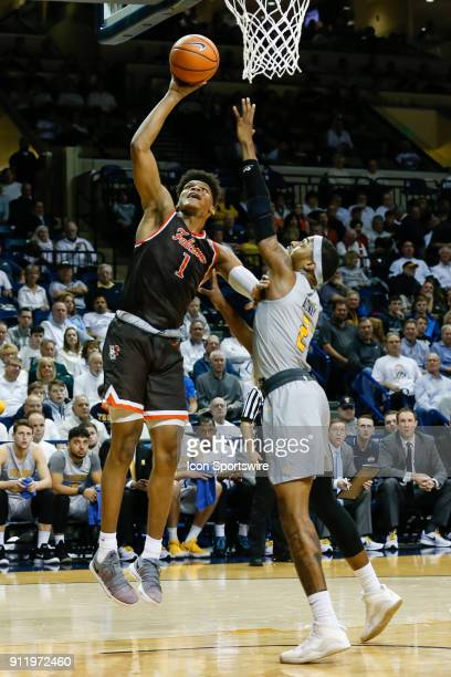 Bowling Green Falcons forward Demajeo Wiggins puts up a shot over Toledo Rockets forward Taylor Adway during the first half of a regular season...