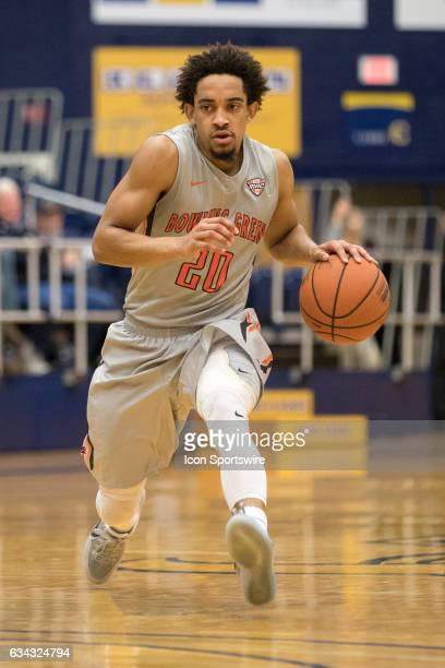 Bowling Green Falcons G Rodrick Caldwell drives to the basket past Kent State Golden Flashes G Kevin Zabo during the first half of the men's college...