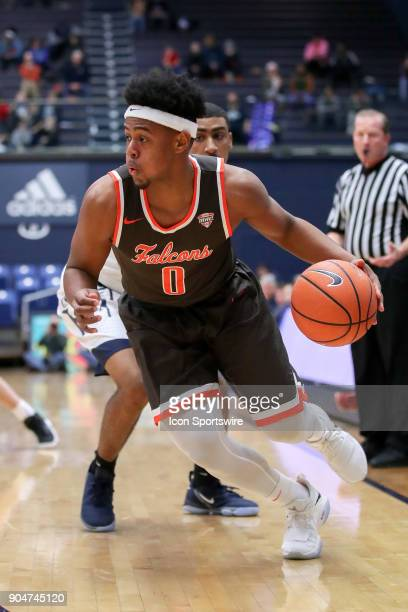 Bowling Green Falcons guard Nelly Cummings drives to the basket during the first half of the men's college basketball game between the Bowling Green...