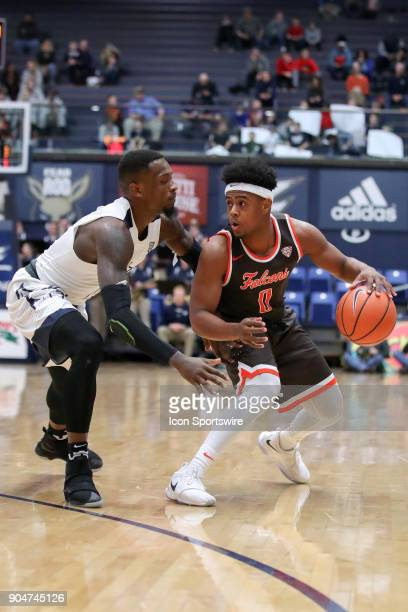Bowling Green Falcons guard Nelly Cummings is defended by Akron Zips guard Jimond Ivey during the first half of the men's college basketball game...