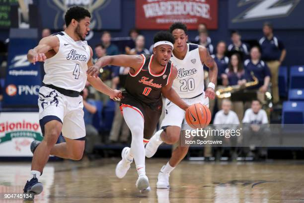 Bowling Green Falcons guard Nelly Cummings is defended by Akron Zips guard Malcolm Duvivier and Akron Zips guard Eric Parrish during the first half...