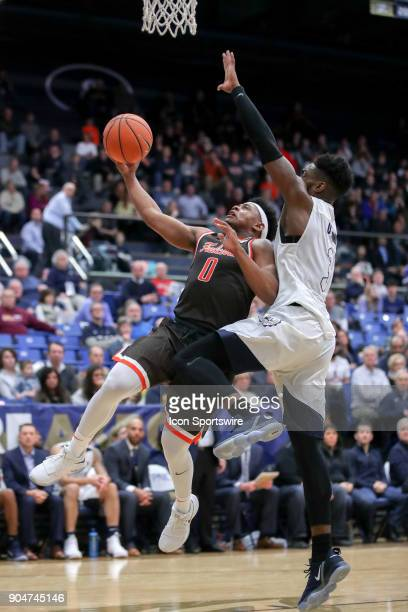 Bowling Green Falcons guard Nelly Cummings shoots as Akron Zips forward Daniel Utomi defends during the first half of the men's college basketball...