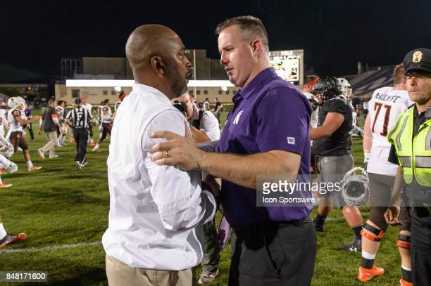 Bowling Green Falcons head coach Mike Jinks and Northwestern Wildcats head coach Pat Fitzgerald shake hands and talk after a college football game...