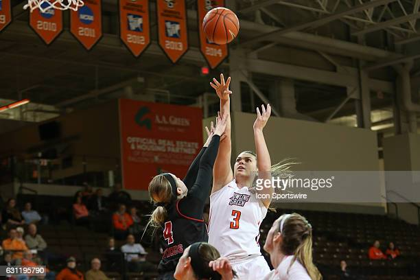 Bowling Green guard Andrea Cecil shoots a jump shot over Northern Illinois Huskies guard Courtney Woods during a regular season basketball game...