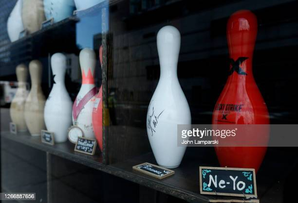 Bowling pins signed by musicians Rihanna and NeYo are displayed in Lucky Strike lounge and bowling alley as the city continues Phase 4 of reopening...