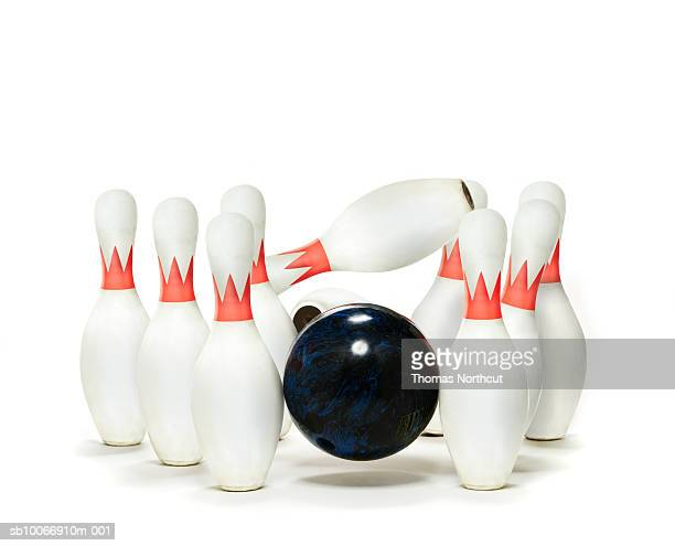 Bowling pins with ball on white background