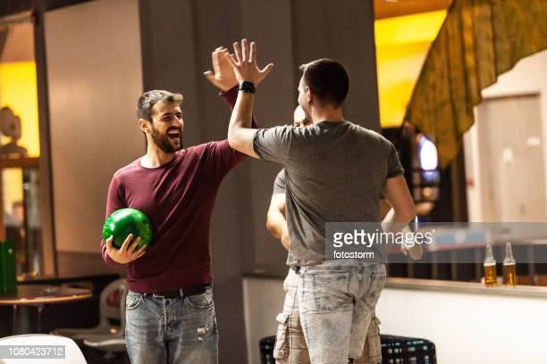 bowling players celebrating the win - bowling stock pictures, royalty-free photos & images