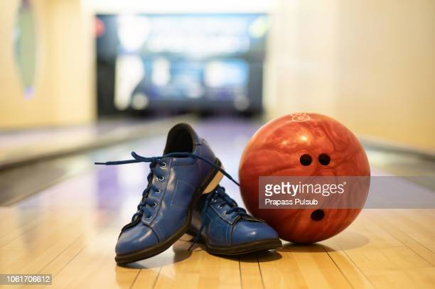 bowling shoes, bowling pins and ball for play in bowling - pair stock pictures, royalty-free photos & images