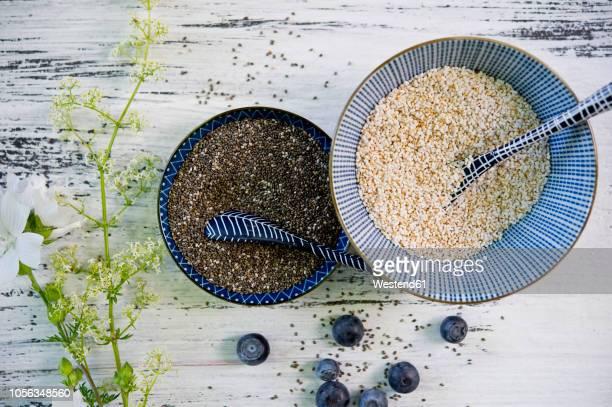 bowls of black chia seeds and amaranth - 抗酸化物質 ストックフォトと画像