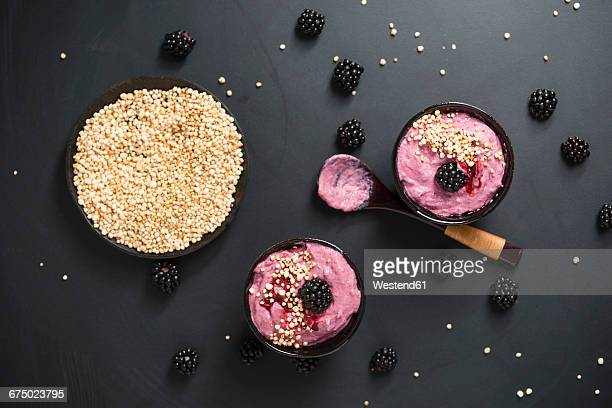 Bowls of blackberry creme with puffed wholemeal quinoa