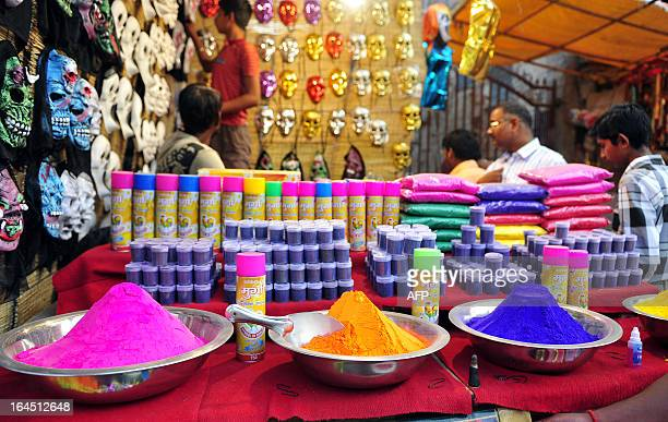 Bowls of colored powder are displayed at a roadside shop ahead of Holi festival in Allahabad on March 24 2013 Holi the popular Hindu spring festival...