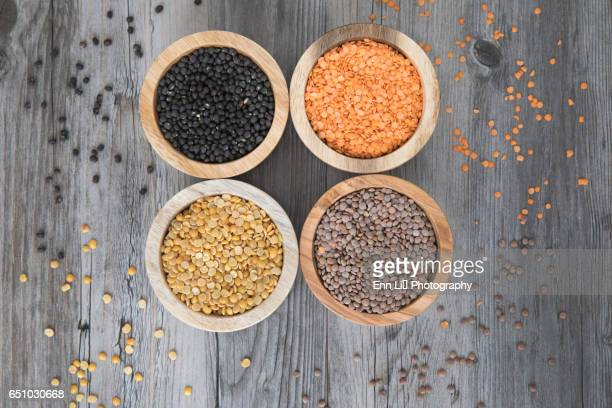 bowls of different lentils - lentil stock pictures, royalty-free photos & images