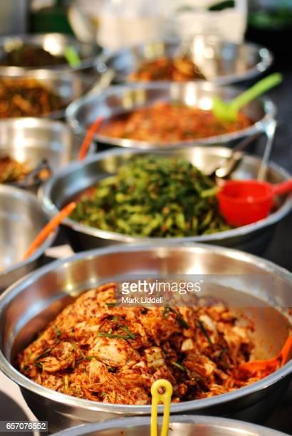 Bowls of kimchi at a market