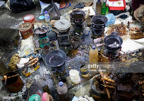 Bowls of molten wax are pictured here at the Danar Hadi batik production company where the monthly wage is around 90 euros and it can take up to five...
