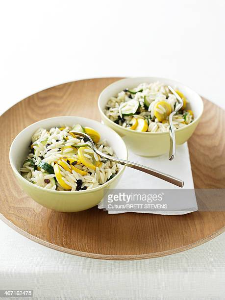 Bowls of orzo, zucchini and mint salad