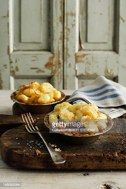 Bowls of potatoes and beef on board