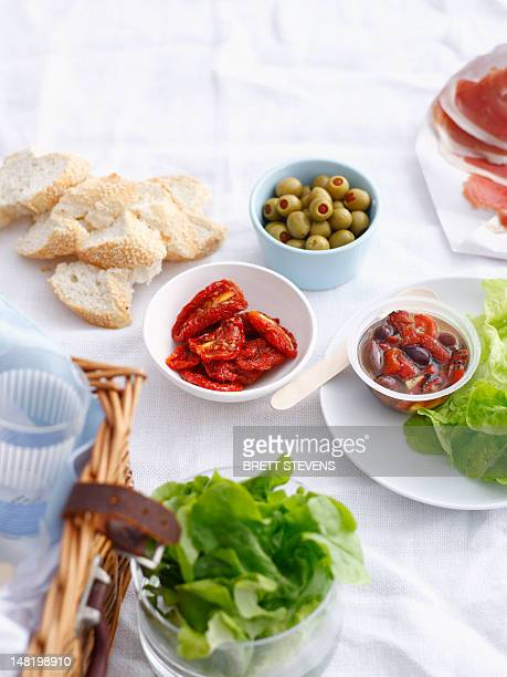 bowls of preserves, bread ad lettuce - olive pimento stock photos and pictures