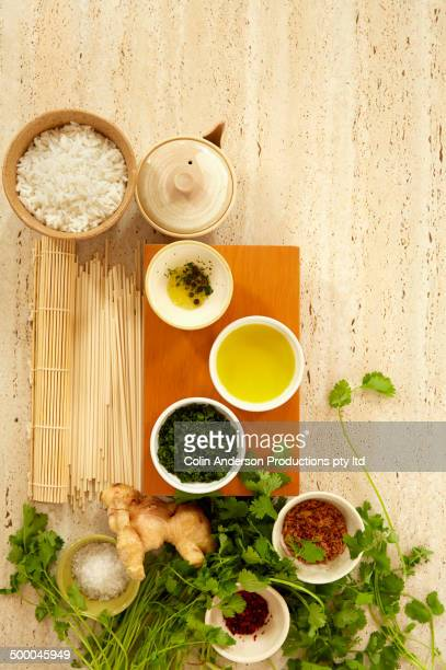 Bowls of rice with tea, ginger and spices