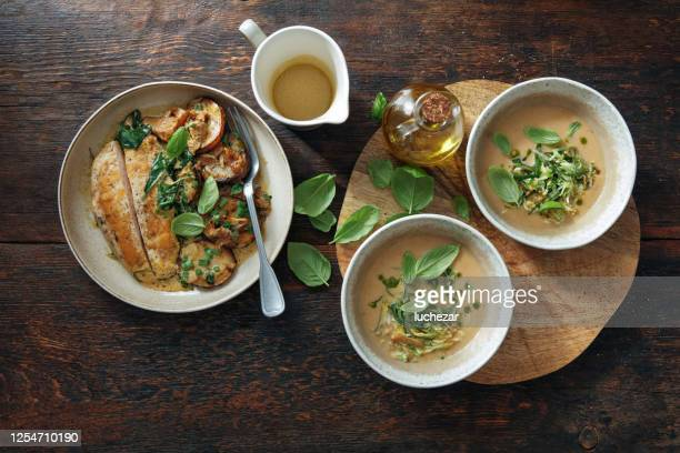 bowls of she-crab soup. roast chicken breast with grilled potatoes - pureed stock pictures, royalty-free photos & images