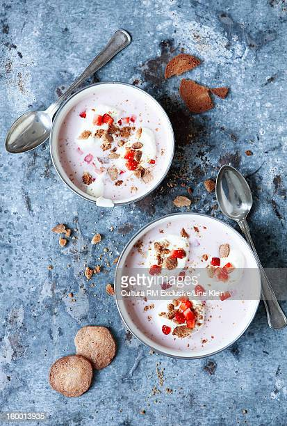 bowls of strawberry and cream dessert - klein stock pictures, royalty-free photos & images