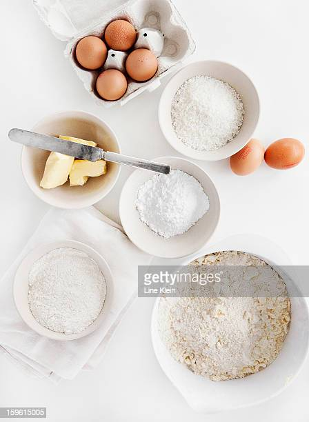 bowls of sugar, flour, eggs, butter - ingredient stock pictures, royalty-free photos & images