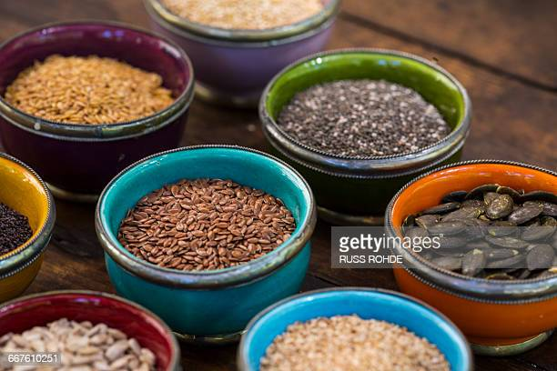 Bowls of sunflower, sesame, pumpkin, linseed,chia, flax and nigella seeds