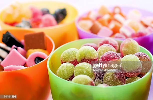 bowls of sweets and candies - sweet food stock pictures, royalty-free photos & images