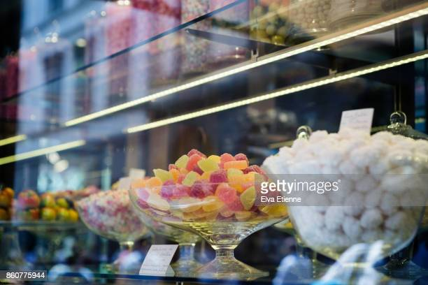 Bowls of sweets on display in a confectionery store in Italy