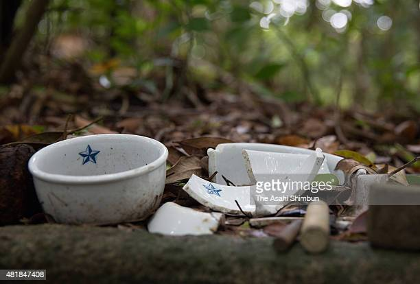 Bowls of the former Japanese Imperial Army soldiers remain on Chichijima Island on May 28 2015 in Ogasawara Tokyo Japan Along with the remains of...