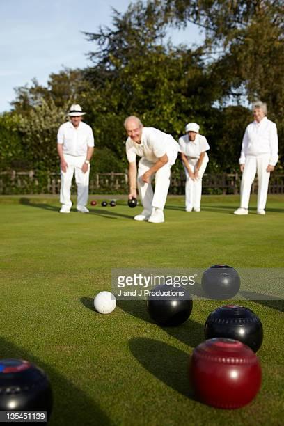 Bowls team playing bowls