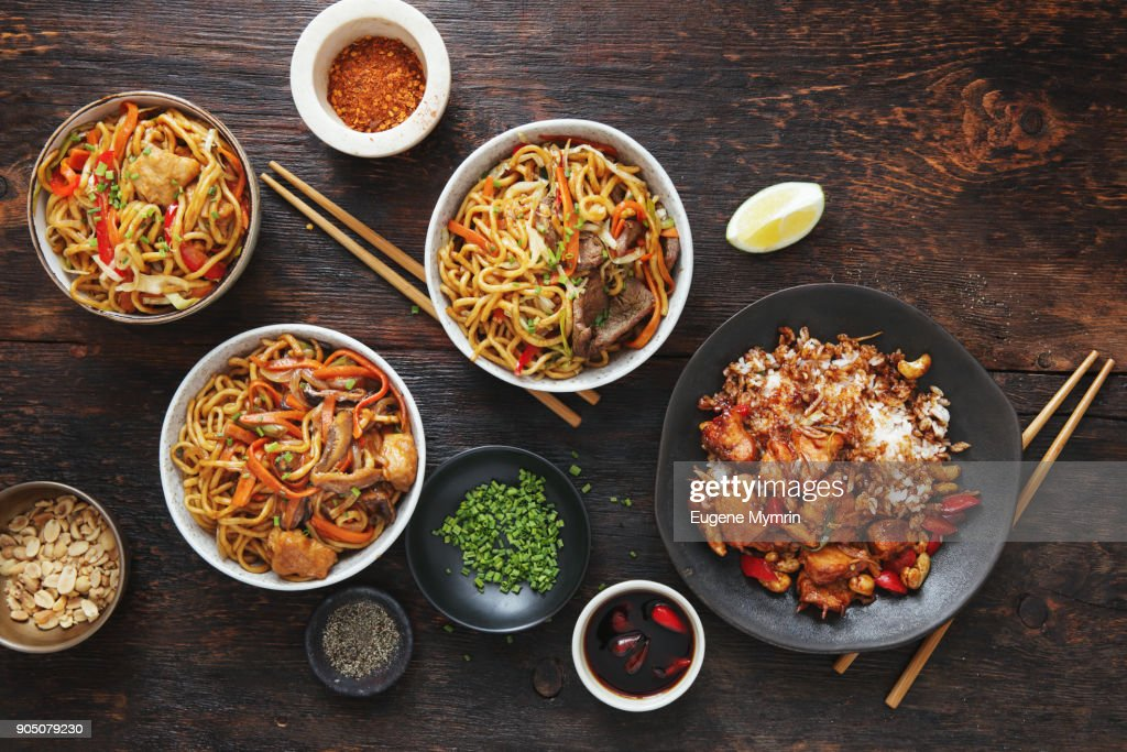 Bowls with chicken, beef and vegetables chow mein and rice with pork : Stock Photo