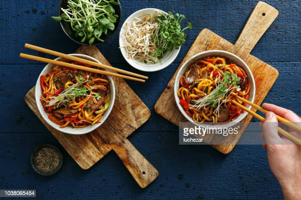 bowls with chow mein - chinese food stock pictures, royalty-free photos & images