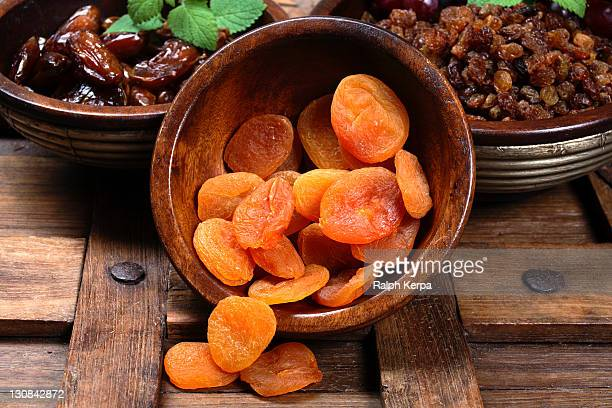 bowls with dried fruits - apricot stock pictures, royalty-free photos & images