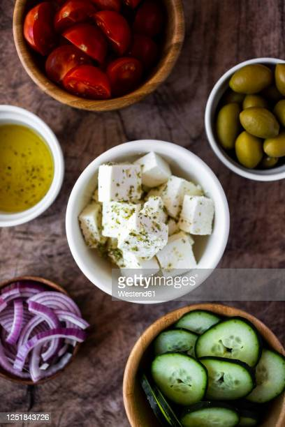 bowls with fresh ingredients for greek salad - feta cheese stock pictures, royalty-free photos & images