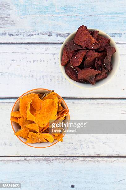bowls with sweet potatoes and beetroot chips