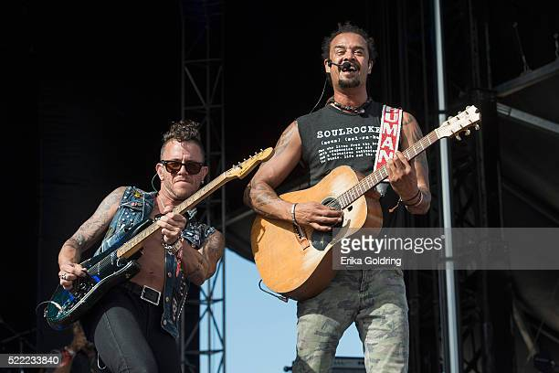 J Bowman and Michael Franti of Michael Franti Spearhead perform in the crowd on April 17 2016 in Fort Lauderdale Florida
