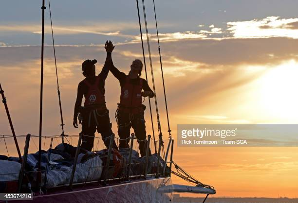 Bowman Sara Hastreiter and Sophie Ciszek high five as Team SCA's Volvo Ocean 65 skippered by Sam Davies finishes at dawn beating the all female round...