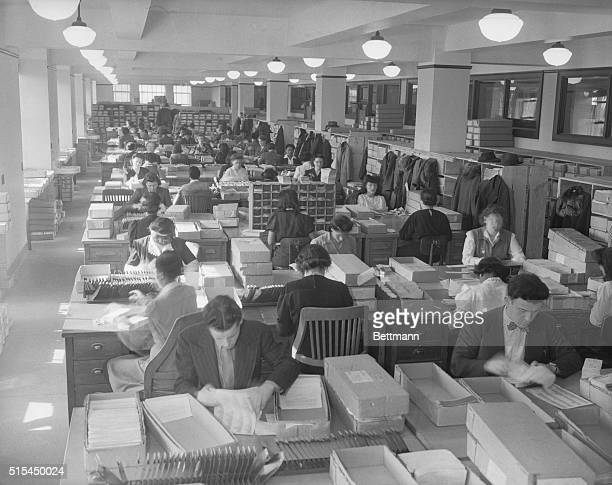 3/14/1944 Box by box an unending stream of income tax documents received from various states flows to the tables where groups of sorters are assigned...