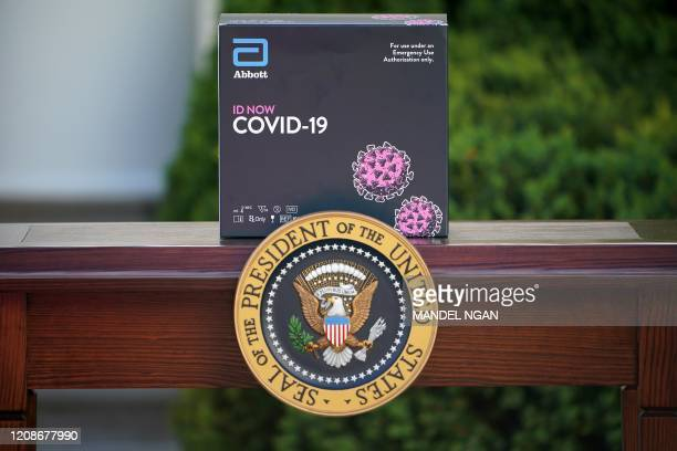 A box containing a 5minute test for COVID19 from Abbott Laboratories is pictured during the daily briefing on the novel coronavirus COVID19 in the...