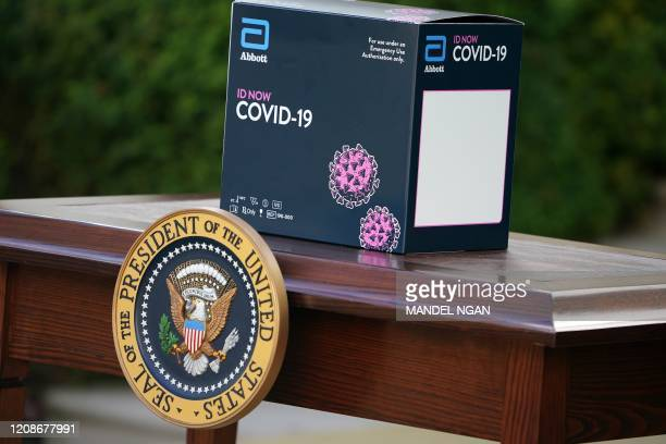 Box containing a 5-minute test for COVID-19 from Abbott Laboratories is pictured during the daily briefing on the novel coronavirus, COVID-19, in the...