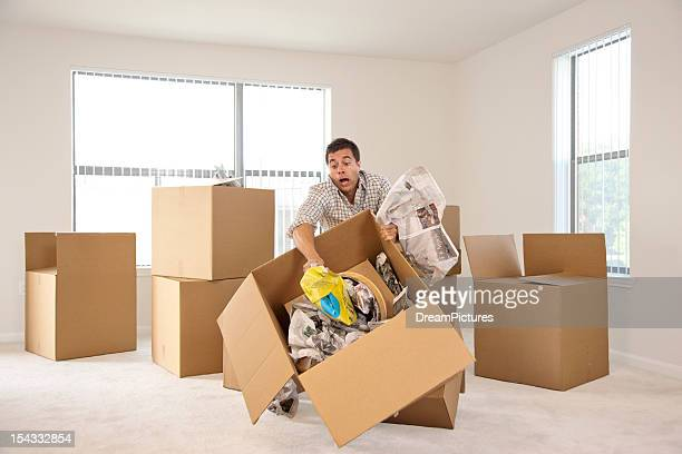 Box falling while man is moving into new house