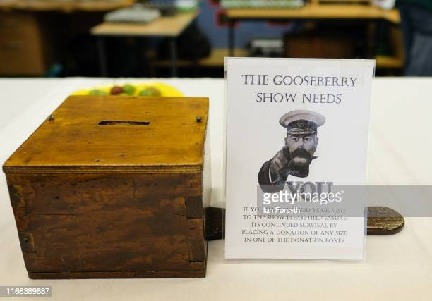 A box for donations stands on a table during the annual Egton Bridge gooseberry show on August 06 2019 in Whitby England The gooseberry show was...