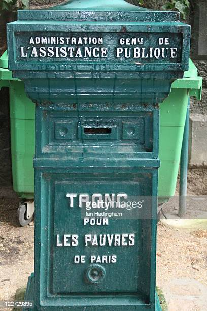 Box for donations to the poor. Taken in the cemetery in Montmartre.