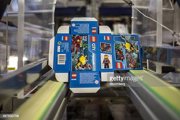 A box from the 'Lego City' collection moves along the packing line at the Lego A/S Factory in Kladno Czech Republic on Monday Nov 16 2015 Lego A/S...