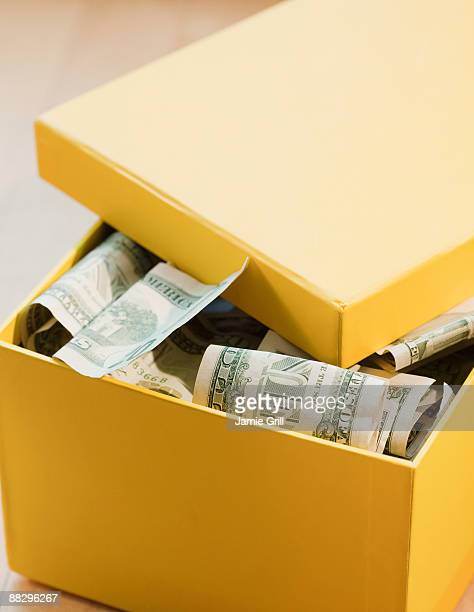 box full of paper money - shoe box stock pictures, royalty-free photos & images