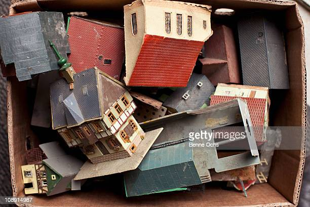 A box full of toy buildings