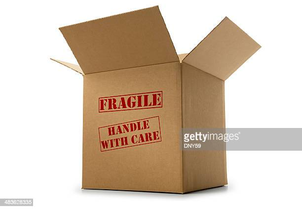 box labeled fragile and handle with care on white background - fragile sign stock pictures, royalty-free photos & images
